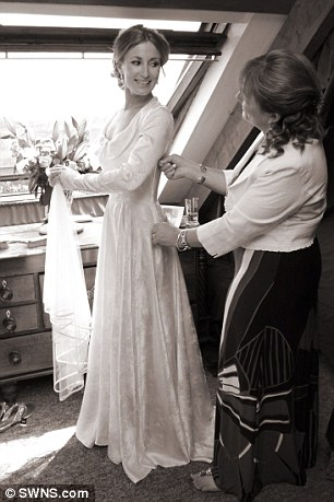 Bride being fitted for her wedding dress